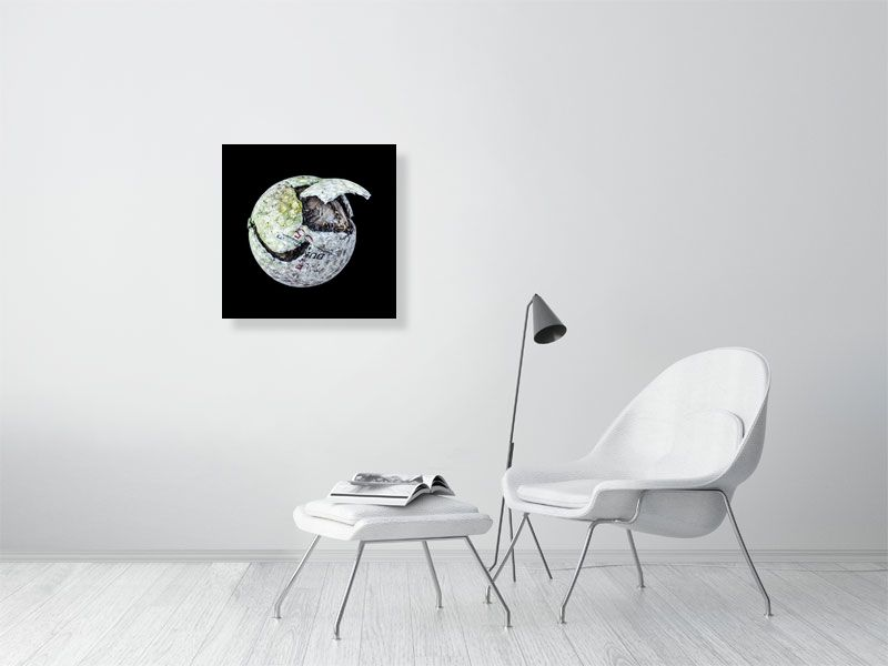 White chipped golf ball on black background print on living room wall