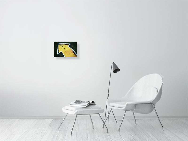 Yellow crazy golf print on living room wall