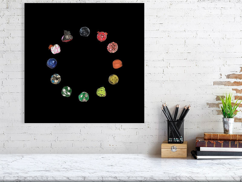 Football wheel collage on black background print above desk