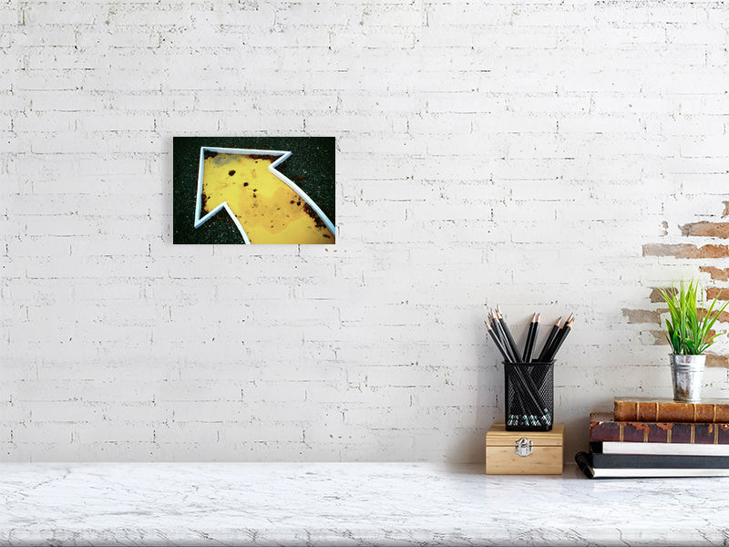 Yellow crazy golf print above desk