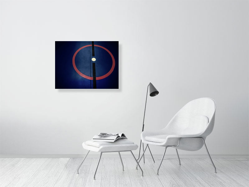 Blue sports hall print with red circle and black line on living room wall