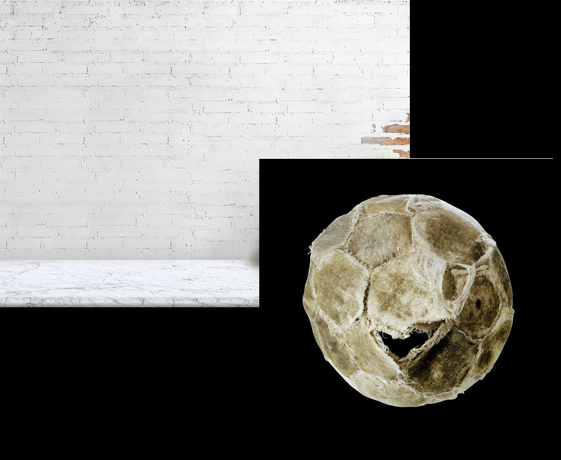 White tattered football on black background print above desk