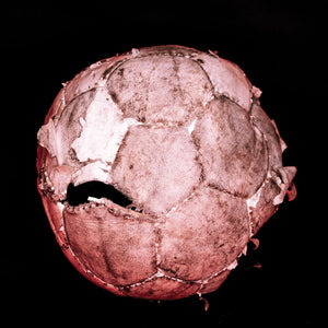 Pink football on black background print