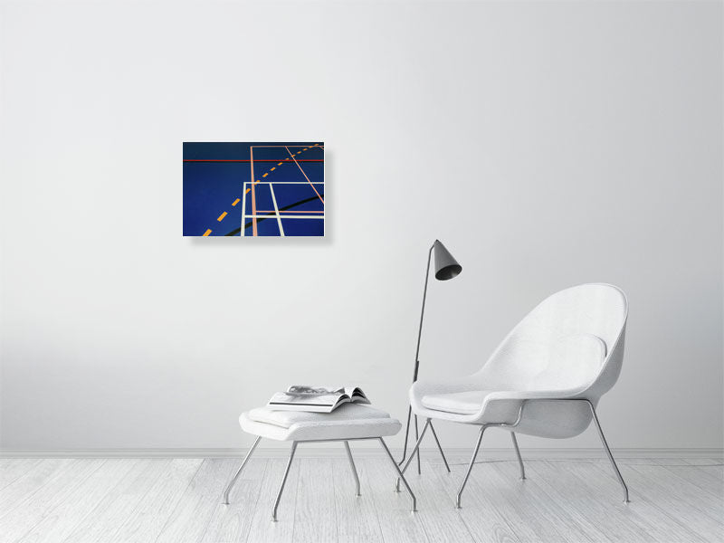 Blue sports hall print with multi-coloured lines on living room wall