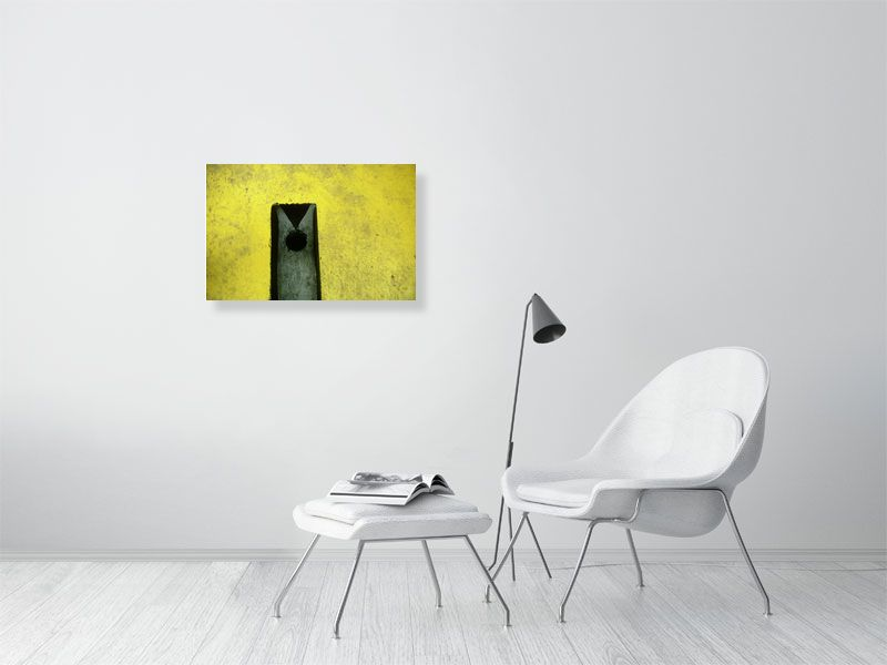 Yellow crazy golf hole print on living room wall