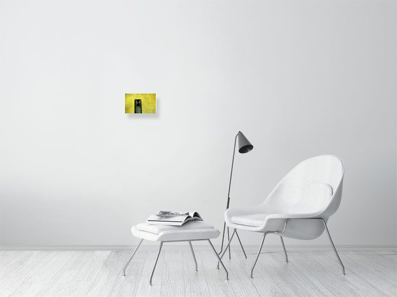 Small yellow crazy golf hole print on living room wall