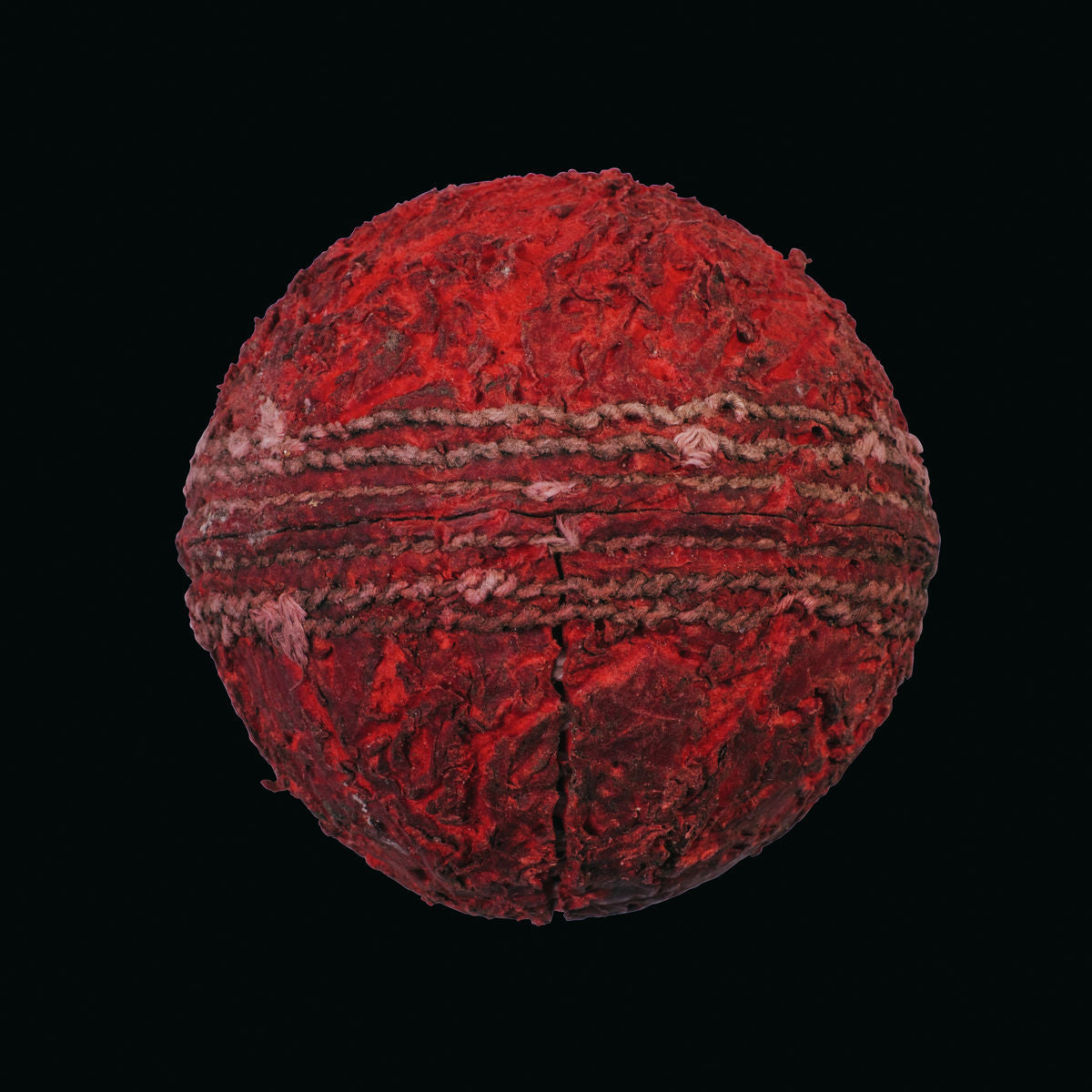 Red cricket ball on black background print