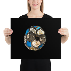 Woman holding blue and white football on black background poster