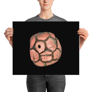 Woman holding light red football on black background poster
