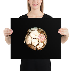 Woman holding white and brown football on black background poster