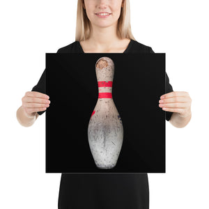 Woman holding red and white bowling print on black background