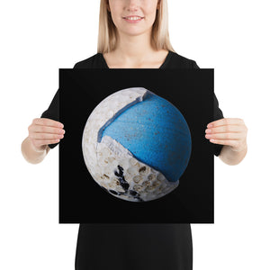 Woman holding blue and white golf ball on black background poster
