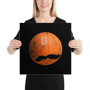 Woman holding orange and black basketball poster on black background