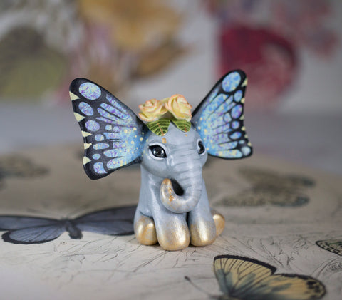 Yellow Rose Butterfant Figurine