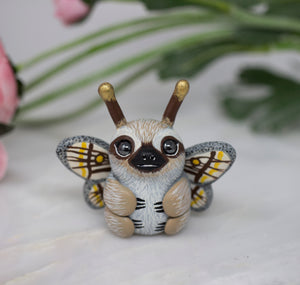 Marbled Emperor Sloth Moth figurine