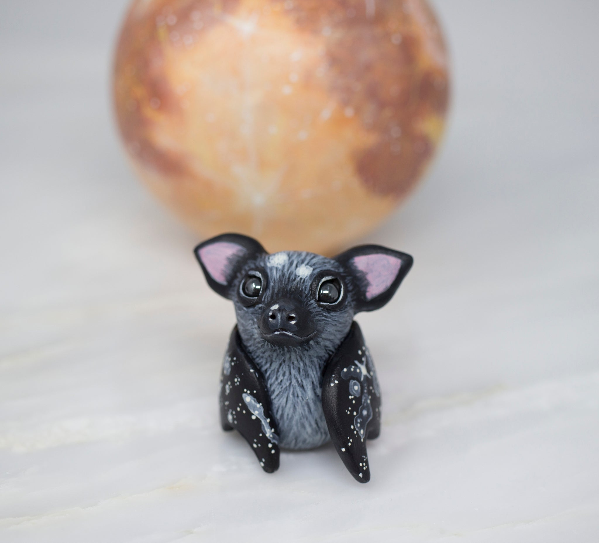 Black Bat Figurine, Spotted