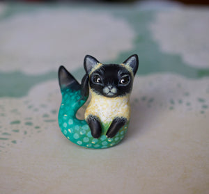 Yellow and teal siamese merkitty figurine