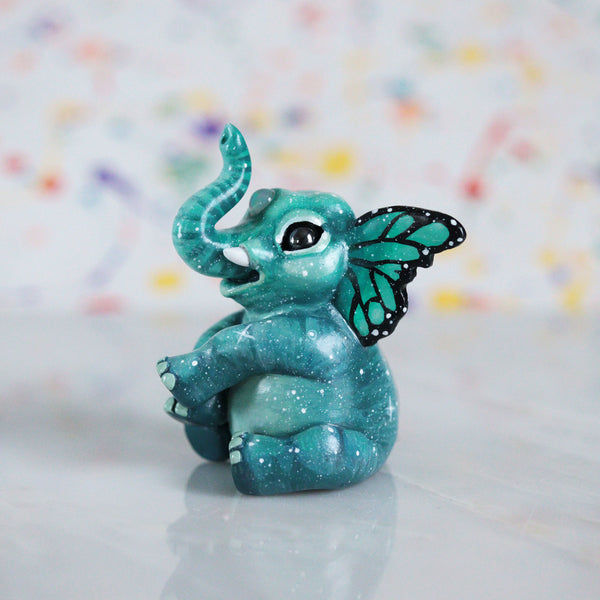 Teal Butterfant Figurine