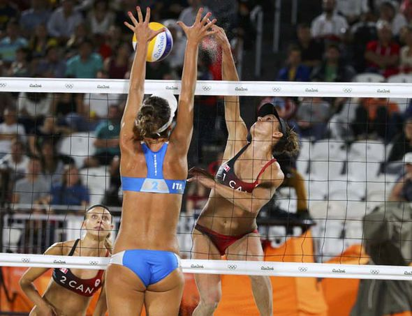 In beach volleyball, women's uniforms are even more revealing than indoor court volleyball.