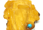 Antique butterscotch color baltic amber carving of Neptune
