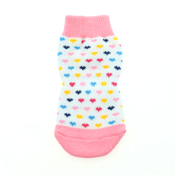 Image of one Non-Skid Dog Sock in white with multi-colored heart pattern.