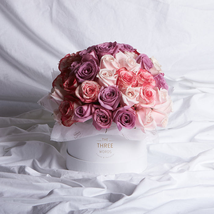 Purple + Light Pink + Multi Pink Roses (Bouquet or Round Box)
