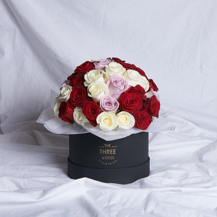 Red + Purple + Creamy White Roses (Bouquet or Round Box)