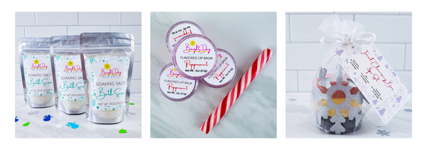 3 pouches of bath snow bath salts, stack of peppermint lip balm, snowflake organza bag with 3 round facial bars: red, white, green.