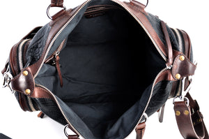 This Leather duffel bag is constructed of the finest Italian Buffalo and Vachetta leathers. It's perfect for weekend trips that securely fits in the plane overhead or under your seat or a short trip to the gym. With 6 pockets inside and out, there's a place for everything. Borlino Onyx and Walnut.