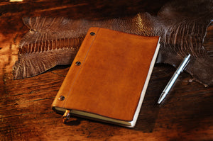 Handmade tan rustic leather journal with replaceable paper. Made in Italy by Borlino.