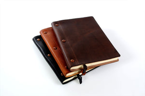 Leather journals in 3 colors with replaceable paper by Borlino Italy.