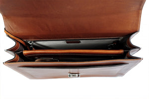 This strong leather double-gusset, key-locking briefcase is made with perfection in every detail. Handmade in Italy by Borlino of the finest Italian vegetable-tanned leathers and metals. Terra Tan Leathers.
