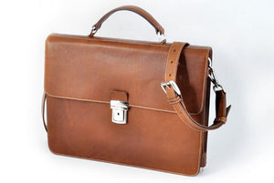 This Italian leather single-gusset, key-locking briefcase is made with perfection in every detail. Handmade in Italy by Borlino of the finest Italian vegetable-tanned leathers and metals. Terra Tan Leathers.