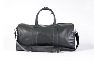 Leather Duffel Bag - This lightweight hand-crafted leather duffel bag is constructed of the finest Italian soft calf leathers. It's perfect for weekend trips that securely fits in the plane overhead. Great for a short trip to the gym or country club as well. The spacious interior also has a secure zippered pocket. Shark Grey.