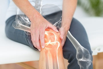 Red Light Showing Inflamation in Mans' Knee