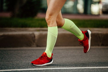 Woman Running in Compression Socks