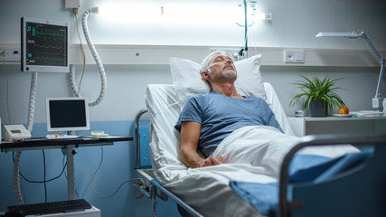 Man in Hospital Recovering from Surgery