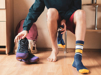 Man Taking Off His Shoes and Socks