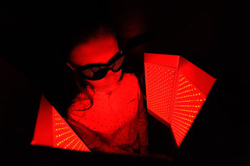 person close to red light therapy devide