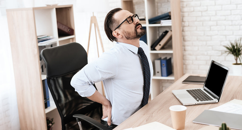 office worker suffering from low back pain