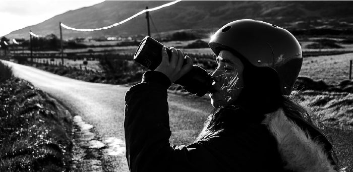 Girl Drinking Water While On A Bike Ride