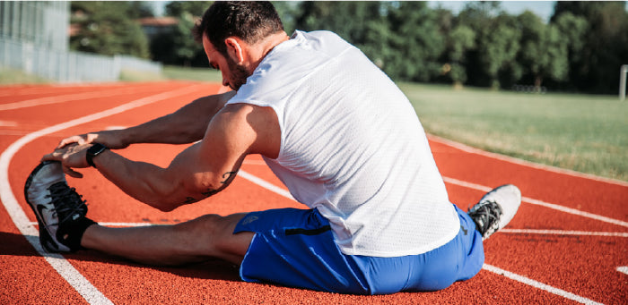 Man stretching after workout