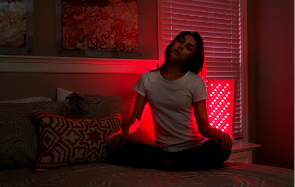 Person using red light therapy