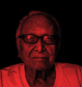 Old Man with red light on his face