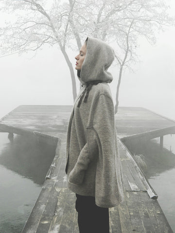 Peaceful woman standing on a dog in foggy weather