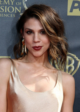 Kate Mansi in gold dress