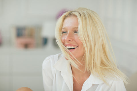 Beautiful blonde woman laughing and happy