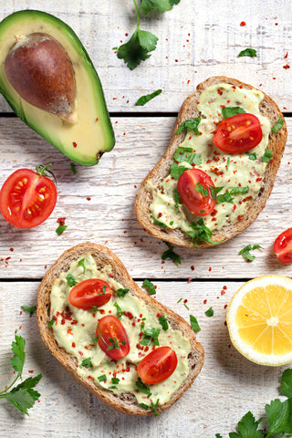 whole wheat bread, avocado toast with cherry tomatos