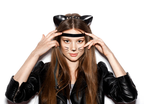 Cat halloween costume. Woman dressed in cat costume