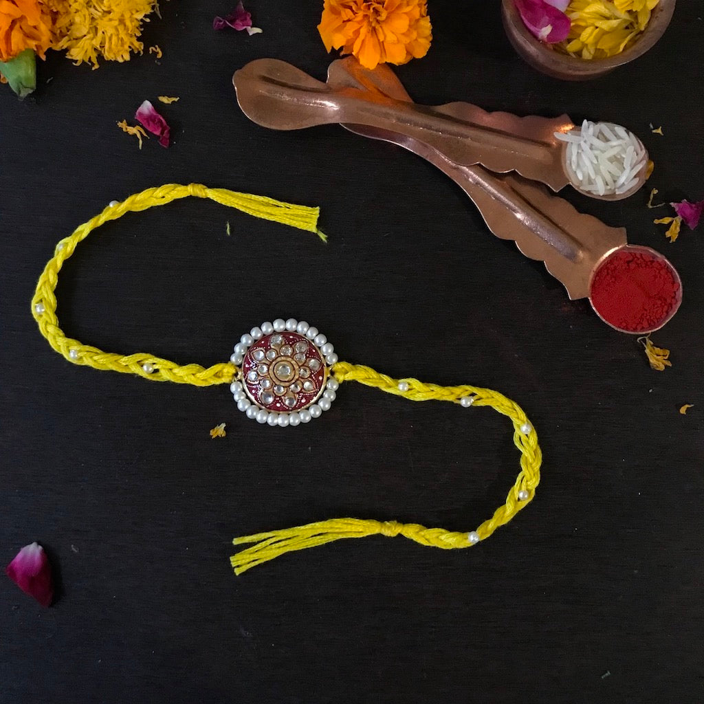 Tanjore Rakhi with Pearls - Yellow & Red